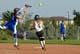 INFIELDER AND RUNNER, LADIES BALL TEAM, SASKATOON