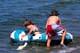 CHILDREN WITH INFLATABLE RAFT, WASKESIU LAKE, PRINCE ALBERT NATIONAL PARK