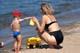 MOTHER AND SON AT BEACH, WASKESIU LAKE, PRINCE ALBERT NATIONAL PARK