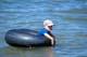 BOY IN INNER TUBE, WASKESIU LAKE, PRINCE ALBERT NATIONAL PARK