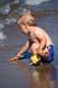 BOY WITH SAND SHOVEL, WASKESIU LAKE, PRINCE ALBERT NATIONAL PARK