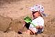 CHILD PLAYING IN SAND, WASKESIU LAKE, PRINCE ALBERT NATIONAL PARK