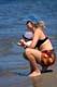MOTHER AND CHILD AT BEACH, WASKESIU LAKE, PRINCE ALBERT NATIONAL PARK