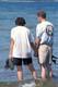COUPLE STANDING IN WATER, WASKESIU LAKE, PRINCE ALBERT NATIONAL PARK