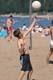 BOY PLAYING BEACH VOLLEYBALL, WASKESIU LAKE, PRINCE ALBERT NATIONAL PARK