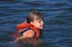 CHILD IN LIFEJACKET, WASKESIU LAKE, PRINCE ALBERT NATIONAL PARK