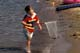 BOY WITH NET ON BEACH, WASKESIU LAKE, PRINCE ALBERT NATIONAL PARK
