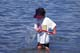 CHILD WITH NET AT LAKE, WASKESIU LAKE, PRINCE ALBERT NATIONAL PARK