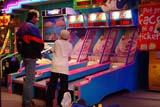 REC ARC MIS  SK  CWN02T0111D  NMR    FATHER AND SON PLAYING ARCADE GAMESASKATOON                            05..© CLARENCE W. NORRIS           ALL RIGHTS RESERVEDACTIVITIES;ARCADES;CHILDREN;COLOURS;FUN;GAMES;INDOORS;MALE;NUMBERS;PEOPLE;PLAINS;PRAIRIES;RECREATION;SASKATCHEWAN;SASKATOON;SHARING;SK_LONE PINE PHOTO                  (306) 683-0889