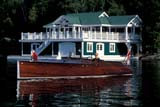 REC BOA MIS  ON  BMM1000066D  NMR  CLASSIC BOATLAKE JOSEPH                      ../..© BEV McMULLEN                ALL RIGHTS RESERVEDACTIVITIES;BOATS;CENTRAL;CLASSICS;COTTAGE;LAKE_JOSEPH;LAKES;MALE;MUSKOKA;ON_;ONTARIO;OUTDOORS;PEOPLE;RECREATION;SHIELD;SUMMER;WATERLONE PINE PHOTO              (306) 683-0889