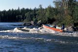 REC BOA MIS  SK     1512605D  NMRMOTORBOAT RUNNING RAPIDSLITTLE STANLEY RAPIDSLAC LA RONGE PROV. PK.    09/09© CLARENCE W. NORRIS      ALL RIGHTS RESERVEDABORIGINALS;BOATS;BOREAL;GEOGRAPHY;LAC_LA_RONGE_PP;LITTLE_STANLEY_RAPIDS;MALE;NORTH;OUTDOORS;PEOPLE;PP_;RAPIDS;RECREATION;RIVERS;SASKATCHEWAN;SK_;SUMMER;WATERLONE PINE PHOTO              (306) 683-0889