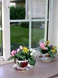 REC CRA MIS  BC  CWN02D2410D  VT SILK FLOWERS ON WINDOW SILL IN SUMMERSALMON ARM                         08/. .© CLARENCE W. NORRIS          ALL RIGHTS RESERVEDBC_;BRITISH;BRITISH_COLUMBIA;BULLETINS;COLUMBIA;CORDILLERA;CRAFTS;DECORATIONS;DISHES;FLOWERS;INDOORS;RECREATION;SALMON_ARM;SILK;VTLLONE PINE PHOTO                  (306) 683-0889
