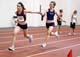 TEEN GIRLS PASSING BATON IN RELAY RACE, SASKATOON