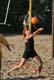 FEMALE PLAYING BEACH VOLLEYBALL, SASKATOON