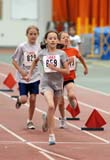 REC TRA MIS  SK  WDS06B1469DX  VTYOUNG GIRLS RUNNING ON TRACKHERSHEY YOUTH PROVINCIAL TRACK AND FIELDSASKATOON                       06/..© WAYNE SHIELS                ALL RIGHTS RESERVEDACTIVITIES;CHILDREN;FEMALE;GIRL;INDOORS;NUMBERS;PEOPLE;PLAINS;PRAIRIES;RACING;RECREATION;RUNNING;SASKATCHEWAN;SASKATOON;SK_;SUMMER;TRACK_&_FIELD;VTLLONE PINE PHOTO              (306) 683-0889