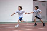 REC TRA MIS  SK  WDS06B1800DXBOYS PASSING BATON IN RELAY RACEHERSHEY YOUTH PROVINCIAL TRACK AND FIELDSASKATOON                       06/..© WAYNE SHIELS                ALL RIGHTS RESERVEDACTIVITIES;BOY;CHILDREN;INDOORS;PEOPLE;PLAINS;PRAIRIES;RACING;RECREATION;RELAY;RUNNING;SASKATCHEWAN;SASKATOON;SASKATOON_FIELD_HOUSE;SK_;SUMMER;TEAMS;TEAMWORK;TRACK_&_FIELDLONE PINE PHOTO              (306) 683-0889