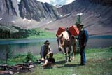 REC TRA RID  AB  DSR 1000140D  NMR WRANGLERS AT RAINBOW LAKEBANFF NAT. PK                    08/..© DUANE S. RADFORD          ALL RIGHTS RESERVEDAB_;ALPINE;ALBERTA;ANIMALS;BANFF_NP;CORDILLERA;COWBOYS;HORSES;LAKES;MALE;MOUNTAINS;NP_;OUTDOORS;PACK_HORSES;PEOPLE;RAINBOW_LAKE;RECREATION;SCENES;WATER;WESTERNLONE PINE PHOTO              (306) 683-0889