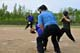 ELEVEN AND TWELVE YEAR OLD CHILDREN PLAYING SOFTBALL, WARMAN