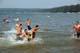 MEN PLAYING WITH A FOOTBALL, WASKESIU LAKE, PRINCE ALBERT NATIONAL PARK
