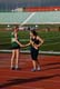 GIRLS SHAKING HANDS, SASKATOON HIGH SCHOOL TRACK AND FIELD MEET, GRIFFITHS STADIUM, SASKATOON