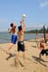 MEN PLAYING BEACH VOLLEYBALL, WASKESIU LAKE, PRINCE ALBERT NATIONAL PARK