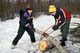 YOUTHS CUTTING FIREWOOD WITH SWEDE SAW, PIKE LAKE