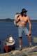 MAN LOADING BARREL OF GEAR INTO CANOE, LAC LA RONGE PROVINCIAL PARK