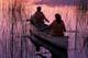 CANOEISTS AT SUNSET, PIKE LAKE, PIKE LAKE PROVINCIAL PARK