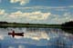 MAN IN RED CANOE, TRAPPER'S LAKE, PRINCE ALBERT NATIONAL PARK