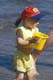 GIRL PLAYING WITH PAIL AT BEACH, EMMA LAKE