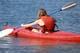 GIRL IN KAYAK, WASKESIU LAKE, PRINCE ALBERT NATIONAL PARK