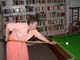 WOMAN PLAYING POOL, SALMON ARM