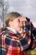 GIRL USING BINOCULARS TO LOCATE BIRDS, LAST MOUNTAIN LAKE