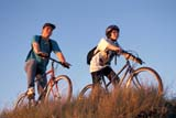 REC BIC MIS  SK     1508516D  MR    TEENAGE BOY AND GIRL BICYCLING ON RIVERBANKSASKATOON                       08/05© CLARENCE W. NORRIS      ALL RIGHTS RESERVEDACTIVITIES;BICYCLING;BICYCLES;CO_ED;COUPLE;FRIENDS;HELMETS;MICHAEL;MR_;OUTDOORS;PEOPLE;PLAINS;PRAIRIES;RECREATION;RURAL;SAFETY;SASKATCHEWAN;SASKATOON;SCENES;SK_;SUMMER;TAMARA;TEENSLONE PINE PHOTO              (306) 683-0889