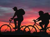 REC BIC MIS  SK  CWN02D3512DA               BOY AND GIRL BICYCLING AT SUNSETDIGITAL COMPOSITEOSLER                                    09/. .© CLARENCE W. NORRIS          ALL RIGHTS RESERVEDACTIVITIES;BICYCLING;BICYCLES;CO_ED;COMPOSITE;COUPLE;FRIENDS;MICHAEL;MR_;OSLER;OUTDOORS;PEOPLE;PLAINS;PRAIRIES;RECREATION;SASKATCHEWAN;SILHOUETTE;SK_;SKY;SUMMER;SUNSETS;TAMARA LONE PINE PHOTO                  (306) 683-0889