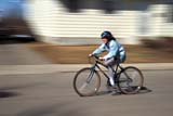 REC BIC MIS  SK   WS21420D  MRGIRL ON BICYCLE WITH HELMETWARMAN                            06..© WAYNE SHIELS                ALL RIGHTS RESERVEDACTIVITIES;BICYCLING;BLUR;CHILDREN;GIRL;HELMETS;MOTION;MR_;OUTDOORS;PEOPLE;PLAINS;PRAIRIES;RECREATION;SAFETY;SASKATCHEWAN;SK_;SPEED;STREETS;SUMMER;TAMARA;WARMANLONE PINE PHOTO              (306) 683-0889
