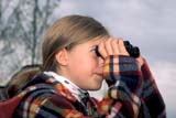 REC BIR MIS  SK     1602458D  MR    GIRL USING BINOCULARS TO LOCATE BIRDSLAST MOUNTAIN LAKE          06/..© CLARENCE W. NORRIS       ALL RIGHTS RESERVEDACTIVITIES;BINOCULARS;BIRDING;BIRD_WATCHING;BULLETINS;GIRL;JENNIE;LAST_MOUNTAIN_LAKE;MR_;OUTDOORS;PEOPLE;PLAINS;PRAIRIES;RECREATION;SASKATCHEWAN;SK_;SUMMERLONE PINE PHOTO               (306) 683-0889