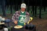 REC CAM MIS  SK     157103D  MR          MAN COOKING AT CAMPCYPRESS HILLS PROV. PK.   07/16© CLARENCE W. NORRIS      ALL RIGHTS RESERVEDACTIVITIES;CAMPFIRES;CAMPING;COOKING;CYPRESS_HILLS_PP;DOUGLAS;FOOD;MALE;MR_;OUTDOORS;PEOPLE;PLAINS;PP_;PRAIRIES;RECREATION;SASKATCHEWAN;SK_;SUMMERLONE PINE PHOTO              (306) 683-0889