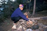 REC CAM MIS  SK      1512727D  MRMAN TENDING FIREDROPE LAKELAC LA RONGE PROV PK     099© CLARENCE W. NORRIS      ALL RIGHTS RESERVEDACTIVITIES;AUTUMN;BOREAL;CAMPFIRES;CAMPING;CANOEING;DROPE_LAKE;FIRE;HATS;LAC_LA_RONGE_PP;LAKES;MALE;MR_;OUTDOORS;PARKLAND;PEOPLE;PP_;RECREATION;SASKATCHEWAN;SHIELD;SK_;SUMMER LONE PINE PHOTO              (306) 683-0889