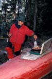 REC CAM MIS  SK     1512724D  MR  VT     WOMAN WITH COFFEE PREPARING BACONDROPE LAKELAC LA RONGE PROV. PK.    09/09© CLARENCE W. NORRIS      ALL RIGHTS RESERVEDACTIVITIES;AUTUMN;CAMPING;CANOES;CANOEING;COOKING;DROPE_LAKE;FEMALE;FOOD;LAC_LA_RONGE_PP;LAKES;MR_;OUTDOORS;PARKLAND;PARKS;PEOPLE;PLAINS;PP_;PRAIRIES;RECREATION;SASKATCHEWAN;SK_;VTL LONE PINE PHOTO              (306) 683-0889