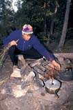 REC CAM MIS  SK     1512725D  MR  VT     MAN TENDING FIREDROPE LAKELAC LA RONGE PROV. PK.    09/09© CLARENCE W. NORRIS      ALL RIGHTS RESERVEDACTIVITIES;AUTUMN;BOREAL;CAMPFIRES;CAMPING;CANOEING;DROPE_LAKE;FIRE;HATS;LAC_LA_RONGE_PP;LAKES;MALE;MR_;OUTDOORS;PARKLAND;PEOPLE;PP_;RECREATION;SASKATCHEWAN;SHIELD;SK_;SUMMER;VTLLONE PINE PHOTO              (306) 683-0889
