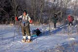 REC CAM WIN  SK     1600132D  MR     MAN ON SNOWSHOES PULLING TOBOGGAN LEADING GROUPWAKAW                             01/07© CLARENCE W. NORRIS      ALL RIGHTS RESERVEDACTIVITIES;CAMPING;HIKING;MALE;MR_;OUTDOORS;PEOPLE;PLAINS;PRAIRIES;RECREATION;SASKATCHEWAN;SK_;SNOW;SNOWSHOES;TOBOGGANS;WAKAW;WINTERLONE PINE PHOTO              (306) 683-0889