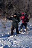 REC CAM WIN  SK     1600203D  MR  VT   WOMAN AND MAN ON SNOWSHOES PACKING IN GEAR TO CAMPWAKAW                             01/07© CLARENCE W. NORRIS      ALL RIGHTS RESERVEDACTIVITIES;CAMPING;CO_ED;COUPLE;FEMALE;HIKING;MALE;MR_;OUTDOORS;PEOPLE;PLAINS;PRAIRIES;RECREATION;SASKATCHEWAN;SK_;SNOW;SNOWSHOES;VTL;WAKAW;WINTERLONE PINE PHOTO              (306) 683-0889