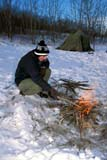 REC CAM WIN  SK     1600415D  MR  VTMAN TENDING CAMPFIRE AT WINTER CAMPWAKAW                             01/07© CLARENCE W. NORRIS      ALL RIGHTS RESERVEDACTIVITIES;BULLETINS;CAMPFIRES;CAMPING;FIRE;MALE;MICHAEL;MR_;OUTDOORS;PEOPLE;PLAINS;PRAIRIES;RECREATION;SASKATCHEWAN;SHELTERS;SK_;SNOW;VTL;WAKAW;WINTERLONE PINE PHOTO              (306) 683-0889