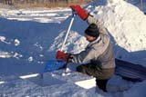 REC CAM WIN  SK     1600426D  MRMAN CUTTING SNOW BLOCKS AT WINTER CAMPWAKAW                             01/07© CLARENCE W. NORRIS      ALL RIGHTS RESERVEDACTIVITIES;CAMPING;IGLOOS;MALE;MR_;OUTDOORS;PEOPLE;PLAINS;PRAIRIES;RECREATION;SASKATCHEWAN;SHELTERS;SK_;SNOW;TOOLS;WAKAW;WINTERLONE PINE PHOTO              (306) 683-0889