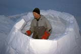 REC CAM WIN  SK     1600724D  MRMAN BUILDING IGLOO AT WINTER CAMPWAKAW                             01/07© CLARENCE W. NORRIS      ALL RIGHTS RESERVEDACTIVITIES;CAMPING;IGLOOS;MALE;MR_;OUTDOORS;PEOPLE;PLAINS;PRAIRIES;RECREATION;SASKATCHEWAN;SHELTERS;SK_;SNOW;STRUCTURES;WAKAW;WINTERLONE PINE PHOTO              (306) 683-0889