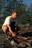 REC CAN MIS  SK     1512127D  MR  VT   MAN BUILDING CAMPFIRELAC LA RONGE PROV. PK.    09/09© CLARENCE W. NORRIS      ALL RIGHTS RESERVEDACTIVITIES;AUTUMN;BOREAL;BULLETINS;CAMPFIRES;CAMPING;CANOEING;FIRE;MALE;MR_;OUTDOORS;PARKLAND;PARKS;PEOPLE;PP_;RECREATION;SASKATCHEWAN;SHIELD;SK_;VTLLONE PINE PHOTO              (306) 683-0889