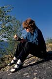 REC CAN MIS  SK     1512213D  MR  VT   WOMAN EATING SHORE LUNCHLAC LA RONGE PROV. PK.    09/09© CLARENCE W. NORRIS      ALL RIGHTS RESERVEDACTIVITIES;AUTUMN;BOREAL;CAMPING;CANOEING;DINING;FEMALE;FOOD;LAC_LA_RONGE_PP;MR_;OUTDOORS;PARKLAND;PEOPLE;PP_;RECREATION;SASKATCHEWAN;SHIELD;SHORELINE;SK_;VTLLONE PINE PHOTO              (306) 683-0889