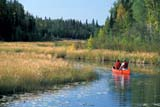 REC CAN MIS  SK     1512228D  MR   COUPLE CANOEING ON CREEKNEAR STANLEY MISSIONLAC LA RONGE PROV. PK.    09/09© CLARENCE W. NORRIS      ALL RIGHTS RESERVEDACTIVITIES;BOREAL;CANOEING;CO_ED;CREEKS;LAC_LA_RONGE_PP;LIFEJACKETS;MALE;MR_;OUTDOORS;PEOPLE;PP_;SAFETY;SASKATCHEWAN;SCENES;SK_;SPORTS;STANLEY_MISSION;SUMMER;WATERLONE PINE PHOTO              (306) 683-0889