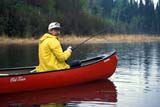 REC CAN MIS  SK     1603660D  MR FISHERMAN IN RED CANOEDEVIL LAKE                          05/30© CLARENCE W. NORRIS      ALL RIGHTS RESERVEDACTIVITIES;CANOEING;DEVIL_LAKE;FISHING;LAKES;MALE;MR_;OUTDOORS;PARKLAND;PEOPLE;RECREATION;SASKATCHEWAN;SCENES;SK_;SPRING;WATERLONE PINE PHOTO              (306) 683-0889